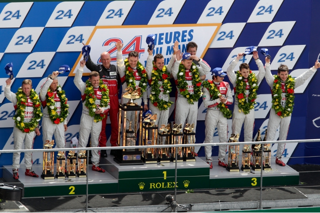 Lotterer, Treluyer and Fassler stand atop the Le Mans podium (Photo Credit: Audi Motorsport)