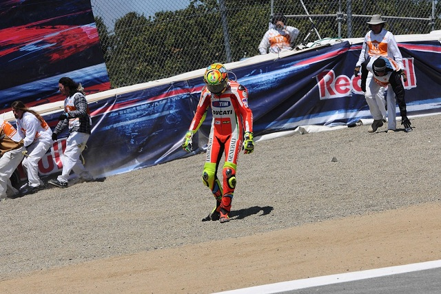 Valentino Rossi trudges away from his damaged Ducati - Photo Credit: MotoGP.com