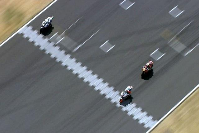 Maverick Vinales (no.25) beats Romano Fenati (no.5) and Sandro Cortese (no.11) to the finish line - Photo Credit: MotoGP.com