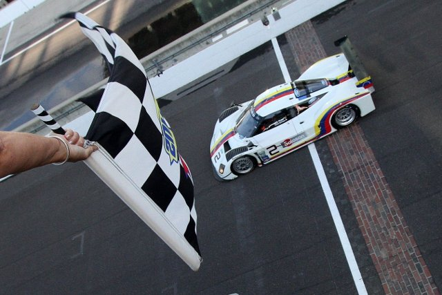 Sebastien Bourdais crosses the yard of bricks victorious (Photo Credit: Grand-Am)