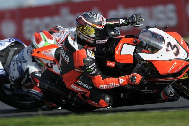 Max Biaggi struck a psychological blow in the championship battle with Marco Melandri by beating him and Tom Sykes to pole position at the Nurburgring