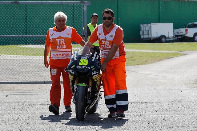Cal Crutchlow's Yamaha is pushed away after its crash - Photo Credit: MotoGP.com