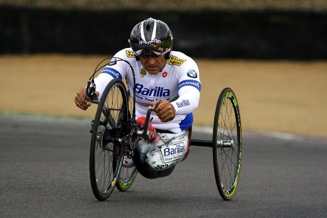 Alex Zanardi won the first of what could be three gold medals at the 2012 Paralympics at Brands Hatch, winning the Hand-Cycling H4 Individual Time Trial by a margin of 27 seconds over German Norbert Mosandl.