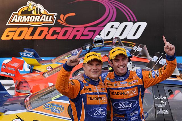 Will Davison and Mika Salo celebrate winning the Sunday race at the Gold Coast 600