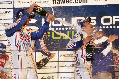 Alex Wurz soaks star man Nakajima on the podium (Photo Credit: Toyota Hybrid Racing)