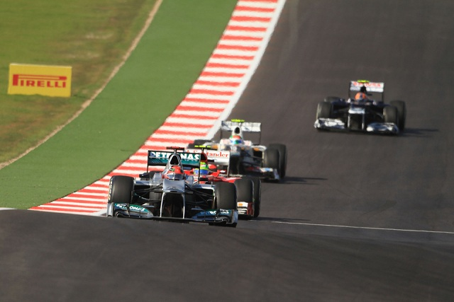 Michael Schumacher regularly came under pressure from cars behind - Photo Credit: OctanePhotos.co.uk