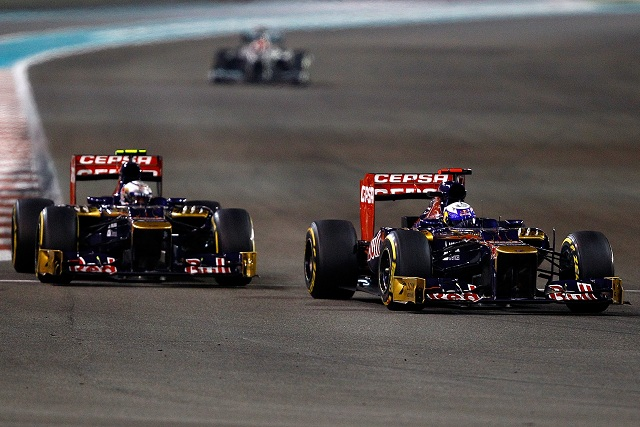 Daniel Ricciardo overtakes Jean-Eric Vergne on his way to tenth place - Photo Credit: Vladimir Rys/Getty Images