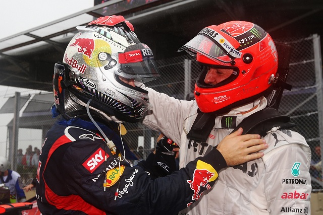 Michael Schumacher congratulates Sebastian Vettel on his third world title - Photo Credit: Paul Gilham/Getty Images