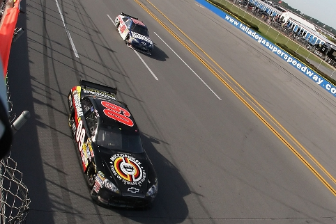 Keselowski as he burst into Victory Lane at Talladega, with his then Nationwide Series car owner Dale Earnhardt Jr. in tow (Photo Credit: Christian Petersen/Getty Images)