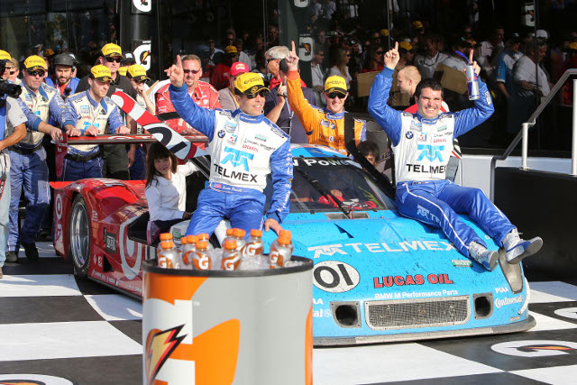 A fifth overall win put Pruett (on car, left) on a par with Hurley Haywood (Photo Credit: Grand-Am)