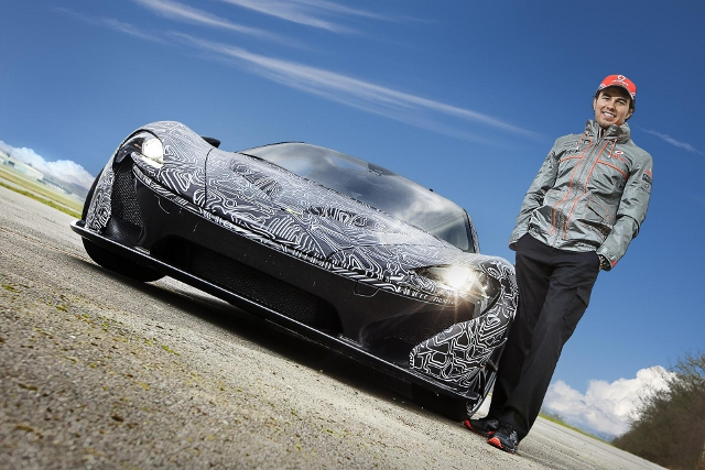 McLaren's new F1 driver with their new supercar (Photo Credit: McLaren Automotive)