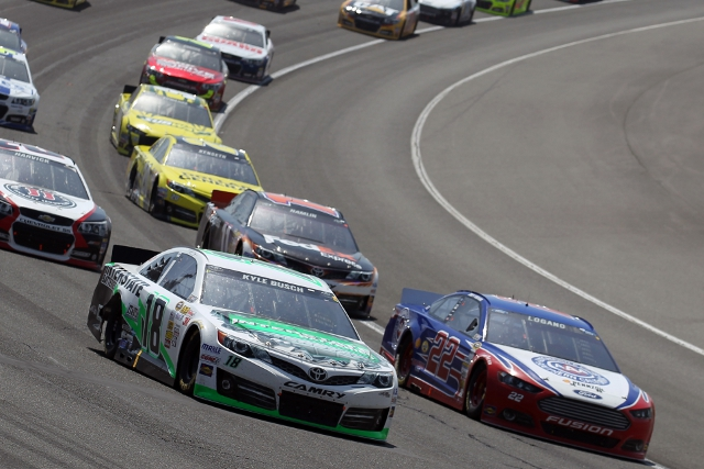 Busch capitalised on turn four contact between Logano and Hamlin (Photo Credit: Todd Warshaw/NASCAR via Getty Images)