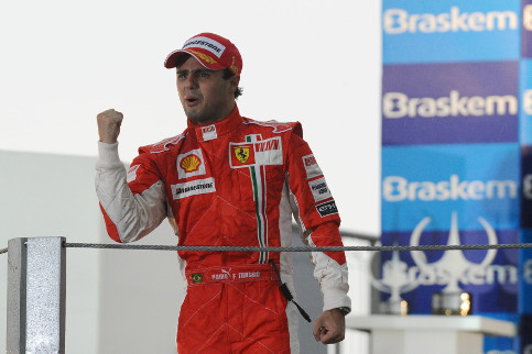 Massa puts on a brave face on the Brazil podium after narrowly missing out on the 2008 title - Credit: Ferrari
