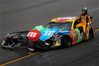 Kyle Busch steps out of his wrecked #18 Toyota (Credit: E d Zurga/Getty Images)