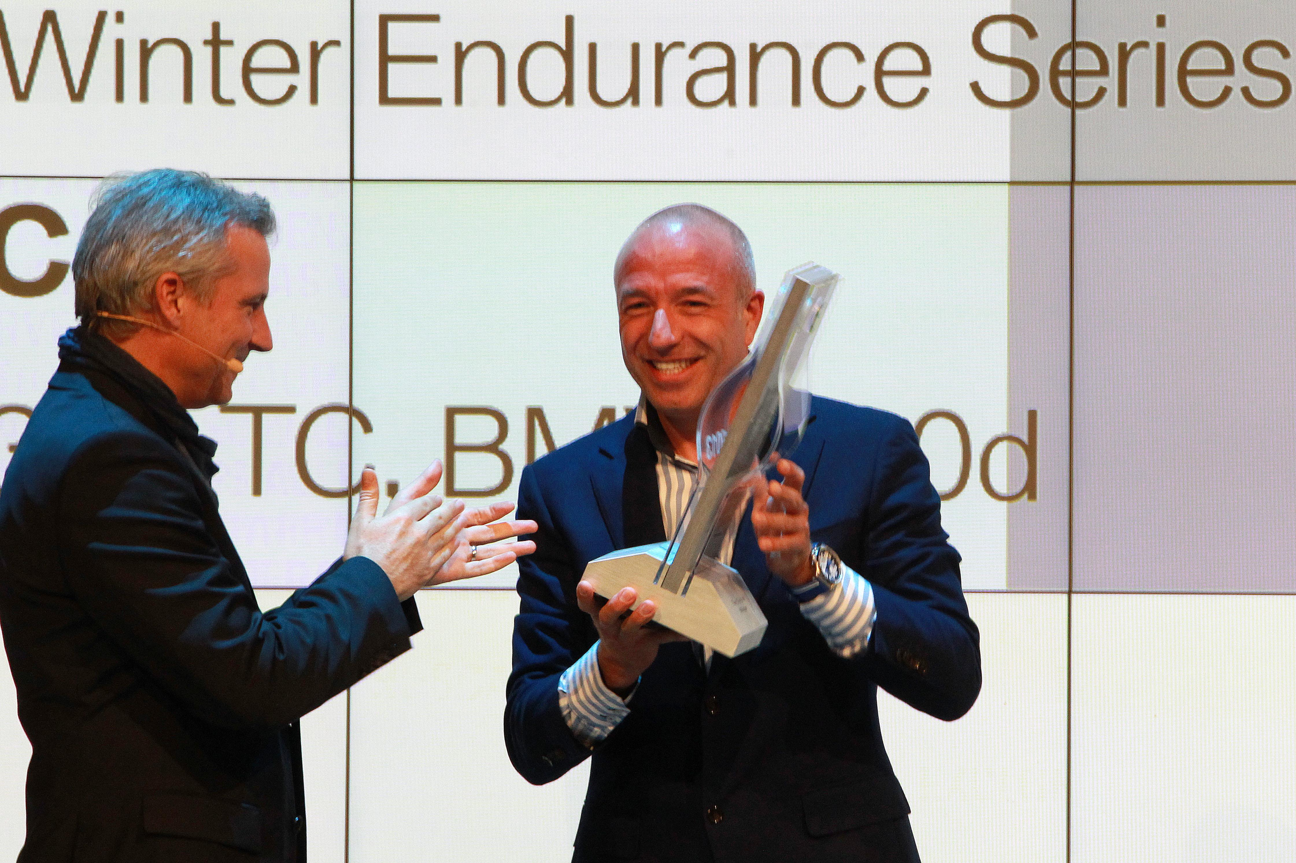 Tom receiving his well-deserved trophy from Herr Marquardt (Credit: BMW Motorsport)