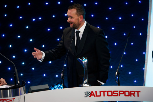 Darren Cox accepts the award during the ceremony (Credit: Autosport/LAT)