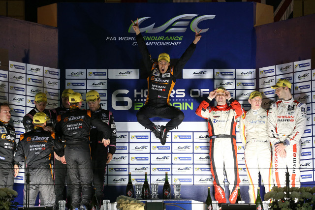Roman Rusinov celebrates high above the all Nissan LMP2 podium (Credit: Clement Marin/DPPI)