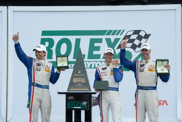 The Action Express Racing team celebrate with their new Rolexes in Victory Lane (Courtesy of IMSA)