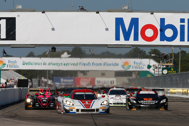 Joao Barbosa leads away at the start of the race (Courtesy of IMSA)