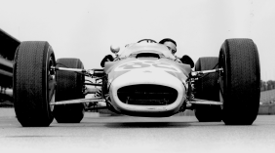 Clark peers round the front of the new-for-'65 Lotus 38 (Credit: Indycar Media)