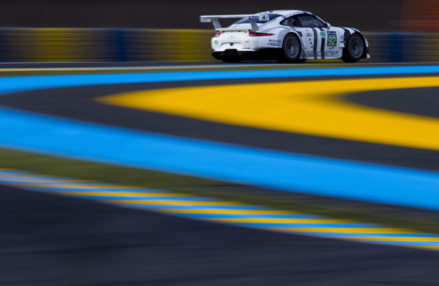 The #92 Porsche 911 RSR at Tetre Rouge, Circuit de La Sarthe.