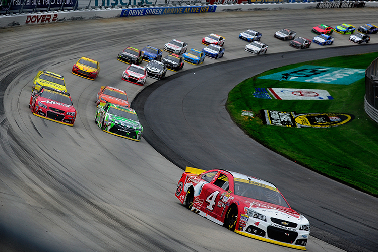DOVER, DE - OCTOBER 04:  Kevin Harvick, driver of the #4 Budweiser/Jimmy John's Chevrolet, leads a pack of cars during the NASCAR Sprint Cup Series AAA 400 at Dover International Speedway on October 4, 2015 in Dover, Delaware.  (Photo by Jeff Curry/Getty Images)