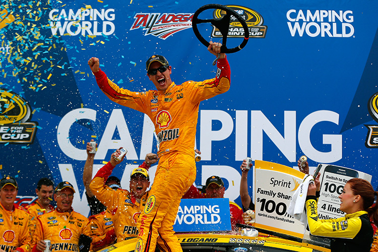TALLADEGA, AL - OCTOBER 25:  Joey Logano, driver of the #22 Shell Pennzoil Ford, celebrates in Victory Lane after winning the NASCAR Sprint Cup Series CampingWorld.com 500 at Talladega Superspeedway on October 25, 2015 in Talladega, Alabama.  (Photo by Jonathan Ferrey/NASCAR via Getty Images)