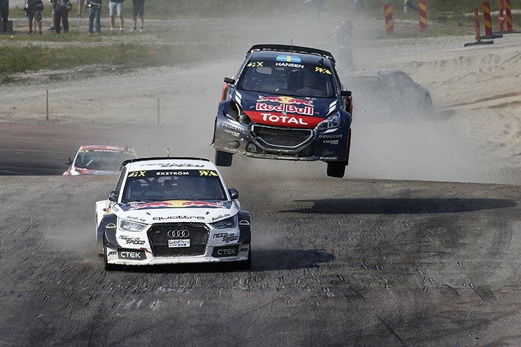 Timmy Hansen chases down Mattias Ekstrom in Sweden - Credit: IMG / FIA World RX