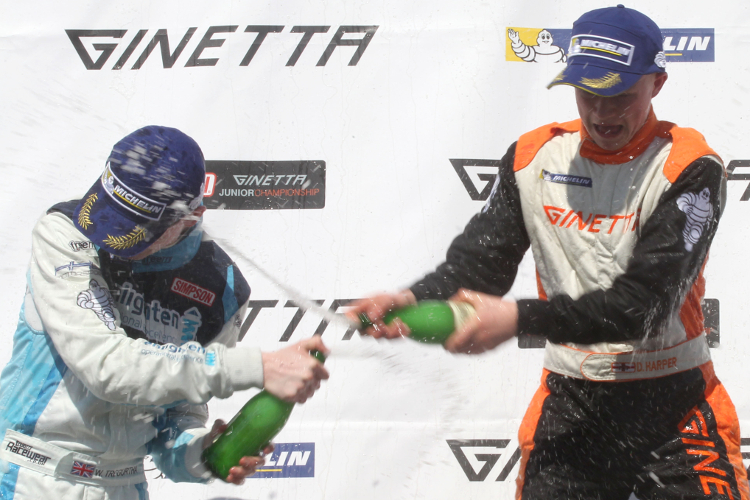 Harper Sprays The Champagne From The Top Step Of The Podium For The First Time - Credit: Jakob Ebrey Photography