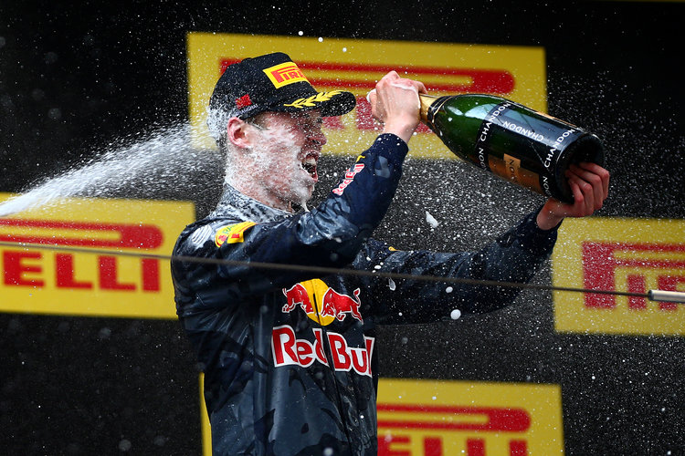 SHANGHAI, CHINA - APRIL 17:  Daniil Kvyat of Russia and Red Bull Racing celebrates on the podium after finishing third in the Formula One Grand Prix of China at Shanghai International Circuit on April 17, 2016 in Shanghai, China.  (Photo by Dan Istitene/Getty Images)