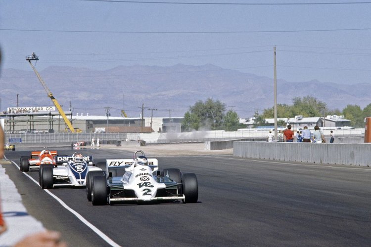 Caesars Palace, USA, 15th - 17th October 1981, RD15. Carlos Reutemann, Williams FW07D-Ford, leads Nelson Piquet, Brabham BT49-Ford, and Mario Andretti, Alfa-Romeo 179D. Action. Photo: LAT Photographic/Williams F1. Ref: 1981williams01
