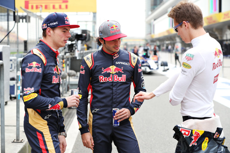 SHANGHAI, CHINA - APRIL 14: Max Verstappen of Netherlands and Scuderia Toro Rosso, Carlos Sainz of Spain and Scuderia Toro Rosso and Daniil Kvyat of Russia and Red Bull Racing talk in the Pitlane during previews to the Formula One Grand Prix of China at Shanghai International Circuit on April 14, 2016 in Shanghai, China.  (Photo by Mark Thompson/Getty Images)