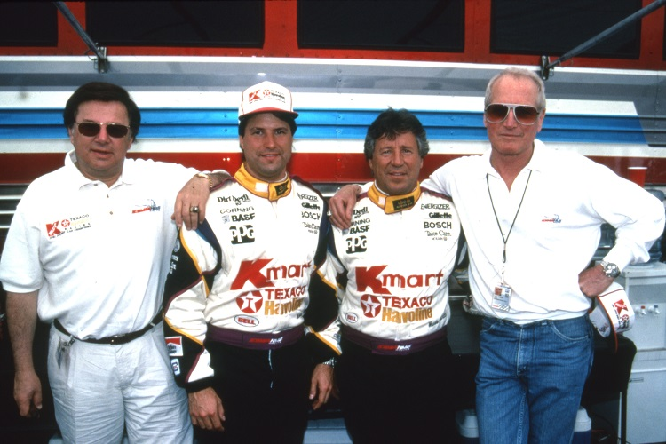 Carl Haas (left) with Michael and Mario Andretti, and actor Paul Newman - Credit: IndyCar
