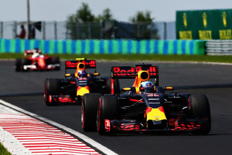 Daniel Ricciardo leads Max Verstappen & Sebastian Vettel - Credit: Charles Coates/Getty Images
