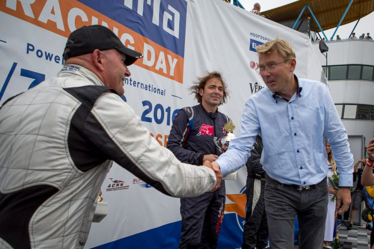 Mika Hakkinen presenting the trophy at BOSS GP