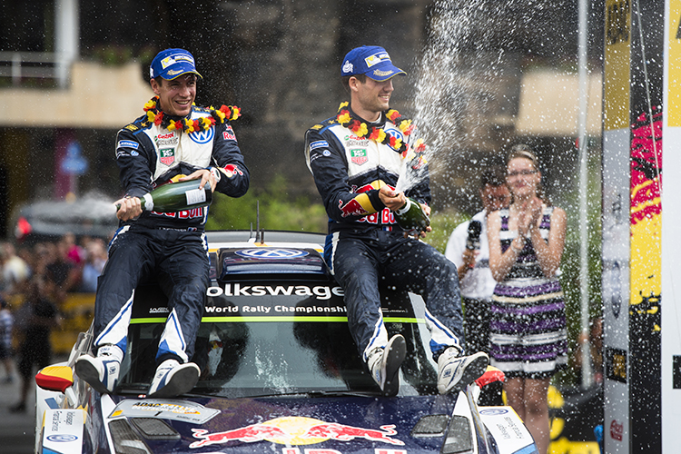 Sebastien Ogier, Julien Ingrassia celebrate on the podium during the FIA World Rally Championship 2015 in Trier, Germany on August 23, 2015 // Jaanus Ree/Red Bull Content Pool // P-20150823-00259 // Usage for editorial use only // Please go to www.redbullcontentpool.com for further information. //