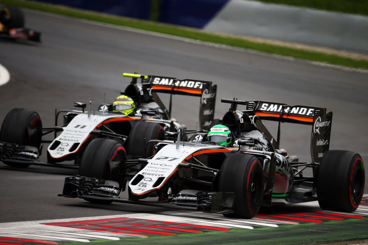 Nico Hulkenberg (GER) Sahara Force India F1 VJM09 and team mate Sergio Perez (MEX) Sahara Force India F1 VJM09. Austrian Grand Prix, Sunday 3rd July 2016. Spielberg, Austria. Credit: Sahara Force India