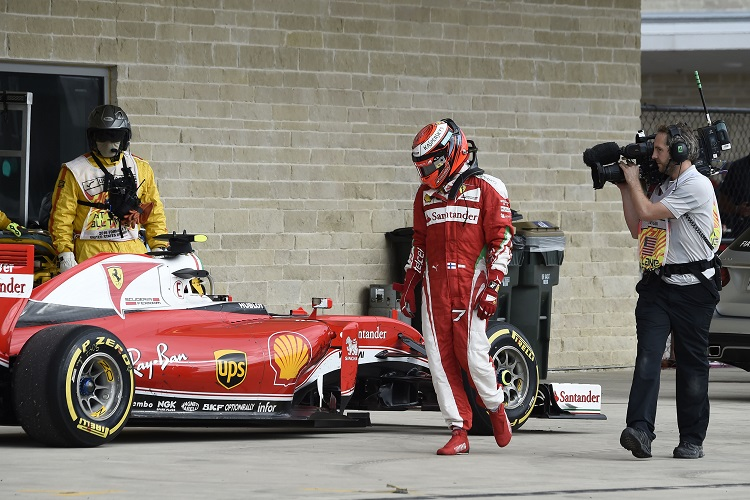 Kimi Raikkonen looks over his stricken Ferrari - Credit: Scuderia Ferrari