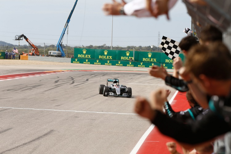 Lewis Hamilton takes the chequered flag at COTA - Credit: Mercedes AMG Petronas Formula One Team