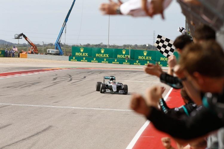 Lewis Hamilton takes the chequered flag at COTA - Credit: Mercedes AMG Petronas Formula One Team