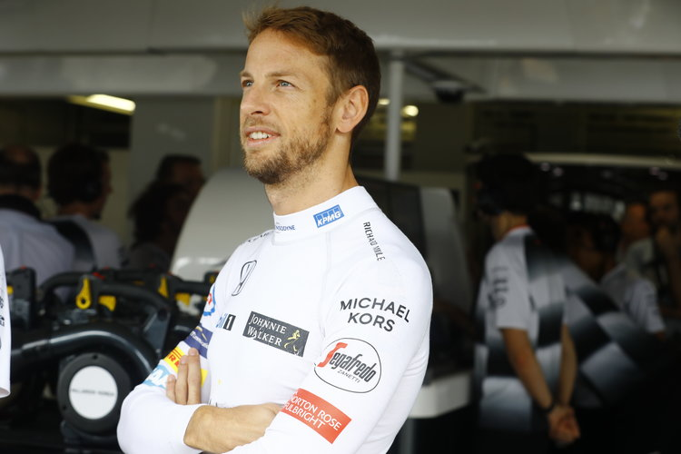 Jenson Button stands in front of the garage. Credit: McLaren Media Centre