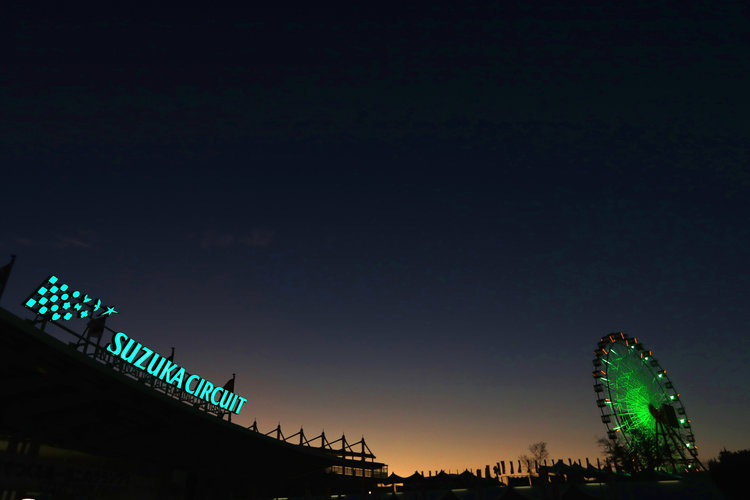 SUZUKA, JAPAN - OCTOBER 06: A general view of the Suzuka Circuit sign and the big wheel as the sun goes down during previews ahead of the Formula One Grand Prix of Japan at Suzuka Circuit on October 6, 2016 in Suzuka.  (Photo by Clive Rose/Getty Images). Credit: Red Bull Content Pool