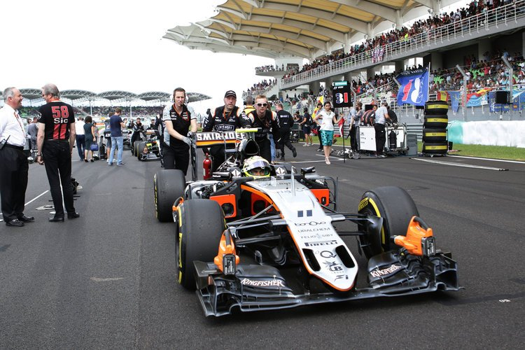 Sergio Perez (MEX) Sahara Force India F1 VJM09 on the grid. Malaysian Grand Prix, Saturday 2nd October 2016. Sepang, Kuala Lumpur, Malaysia. Credit: Sahara Force India