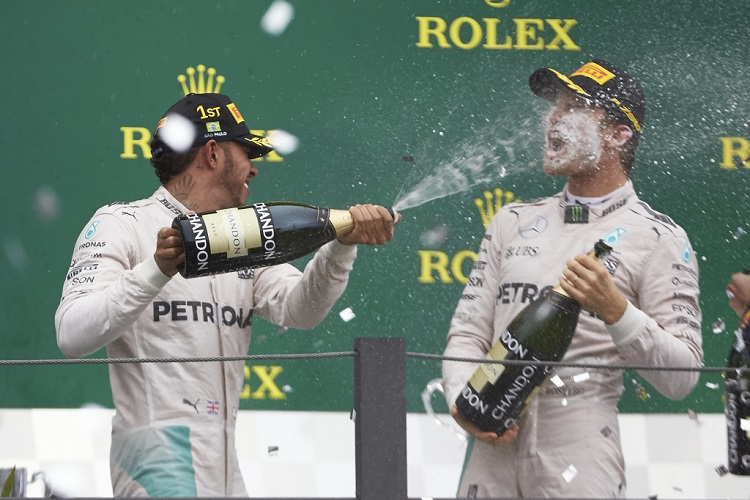 Lewis Hamilton and Nico Rosberg on the podium - Credit: Mercedes AMG Petronas Formula One Team