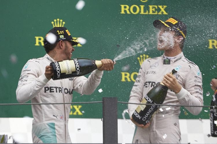 Lewis Hamilton and Nico Rosberg on the podium - Credit: Mercedes AMG Petronas Formula One Team