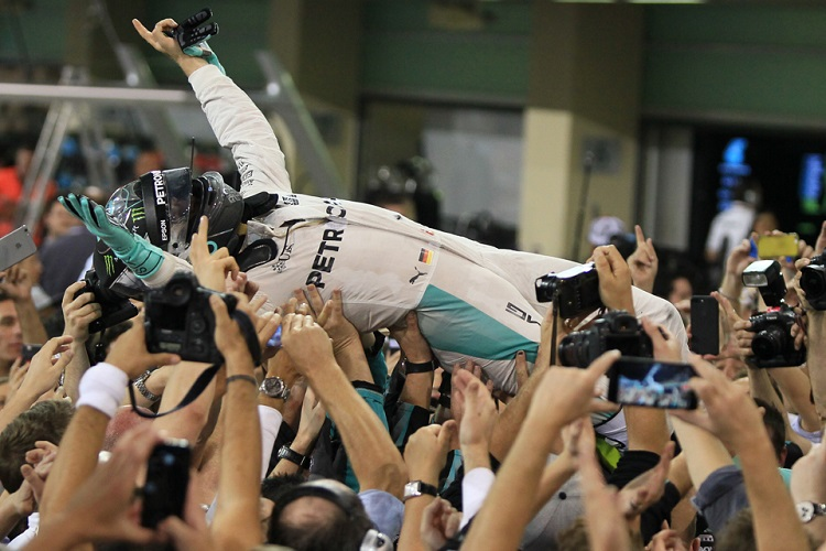 Nico Rosberg celebrates his maiden World Drivers' Championship in Abu Dhabi - Credit: Octane Photographic Ltd