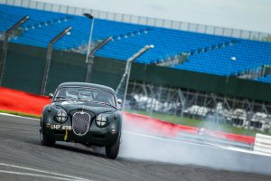 A classic Jaguar on the limit at the 2016 Silverstone Classic.