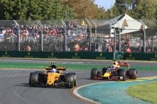 Jolyon Palmer leads a Red Bull through the first and second corner of the Albert Park circuit
