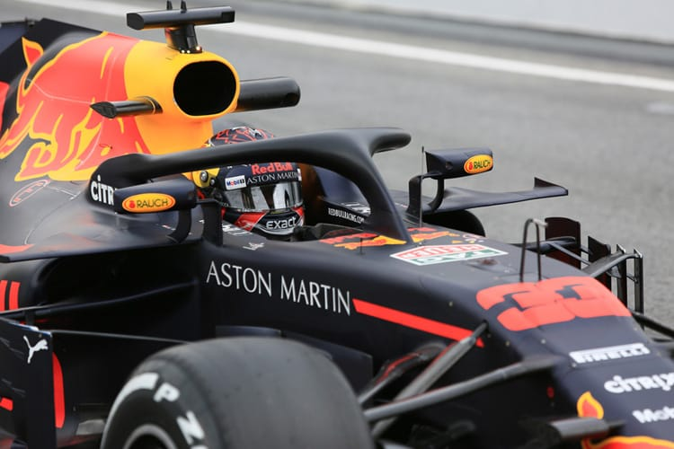 Max Verstappen sits behind the Halo safety device of his RB14 car during 2018 pre-season testing