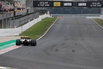 A Renault car drives along the Circuit de Barcelona-Catalunya straight